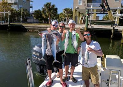 Family Fishing With Fishing Florida Flats. Holding Fish they caught on the Gulf of Mexico.