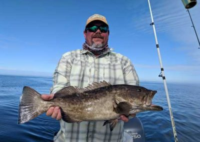 Man holding monster grouper. Fishing florida flats, hudson florida, gulf of mexico.